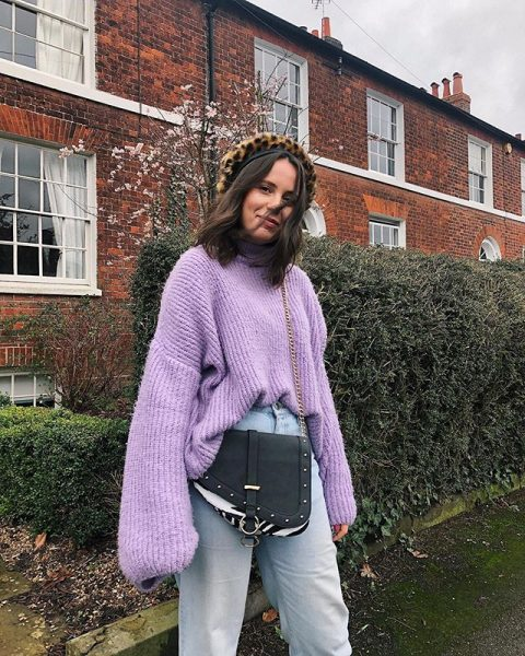 With lilac oversized sweater, black chain strap bag and high-waisted jeans
