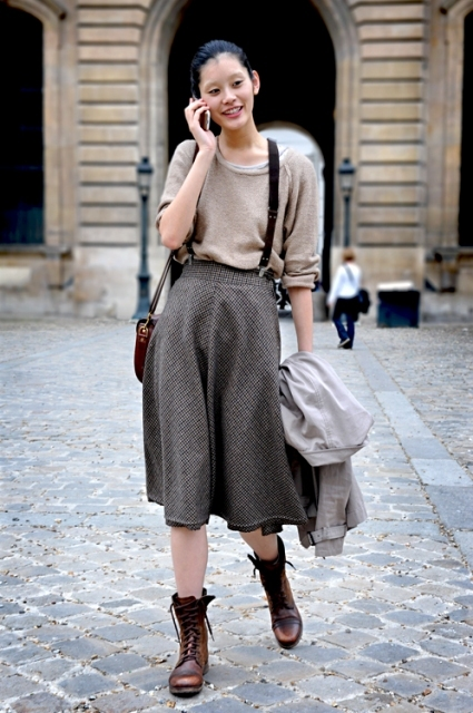 With loose shirt, printed skirt and gray coat
