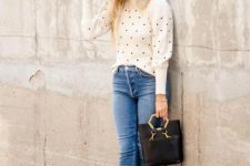 With navy blue hat, black bag, cropped jeans and black shoes