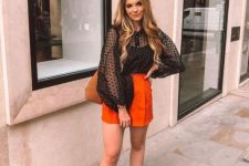 With orange mini skirt, brown bag and white ankle boots