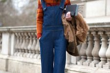 With orange turtleneck sweater, faux fur jacket and cutout boots