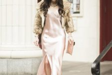 With pale pink satin maxi dress, clutch and high heels