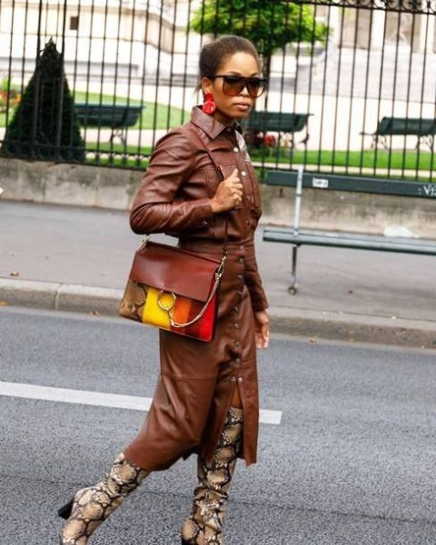 With printed boots and colorful bag