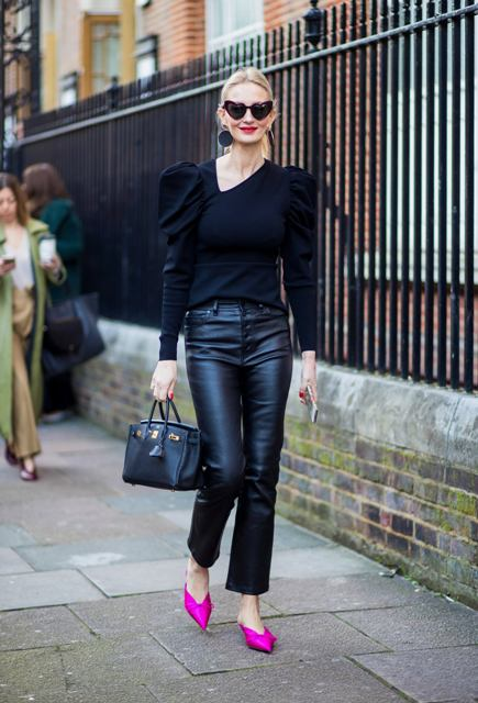 With puff sleeved sweater, black bag and pink mules