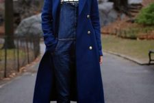 With striped shirt, navy blue midi coat and black and white sneakers