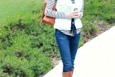 With striped shirt, plaid scarf, brown bag, jeans and brown high boots