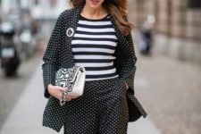 With striped shirt, polka dot suit, black shoes and printed bag