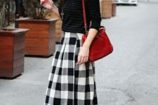 With striped shirt, red bag and flat shoes