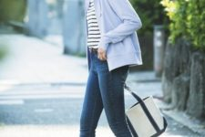 With striped shirt, skinny jeans, black and white tote bag and sneakers