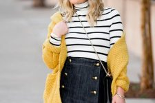 With striped turtleneck, denim mini skirt, yellow cardigan, chain strap bag and black over the knee boots