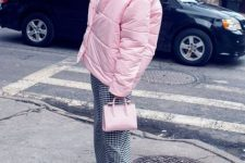 With t-shirt, pale pink mini bag, black and white checked trousers and black low heeled shoes