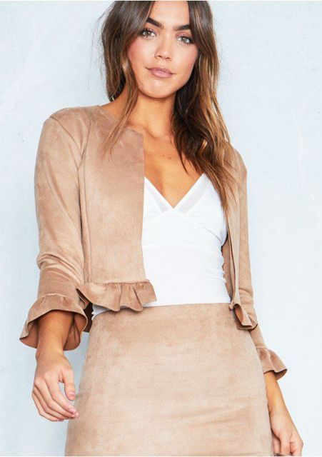 With white V neck top and beige suede skirt