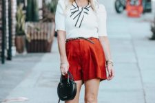 With white blouse, marsala shorts, rounded mini bag and white cutout shoes