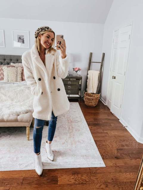 With white faux fur coat, beige shirt, cropped jeans and white ankle boots