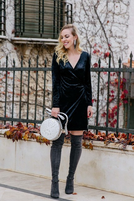 With white rounded bag and gray suede over the knee boots