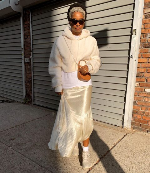 With white shirt, beige satin maxi skirt, brown mini bag and beige sneakers