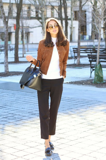 With white shirt, black cropped pants, black leather bag and flat shoes