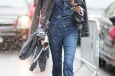 With white shirt, denim jacket, chain strap bag and black mid calf boots