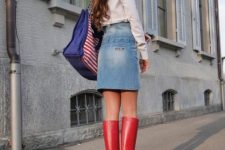 With white shirt, denim skirt, printed tote bag and red high boots
