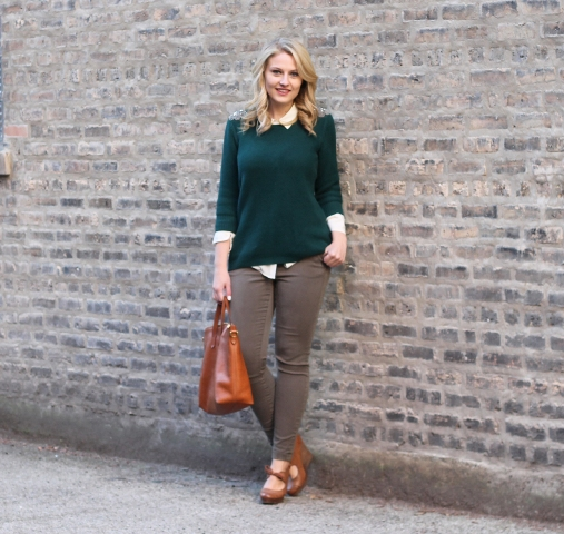 With white shirt, gray jeans, brown shoes and brown tote bag
