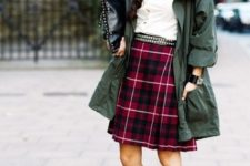 With white shirt, green coat, black clutch and lace up shoes