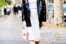 With white shirt, white skirt, black patent leather jacket and pale pink bag