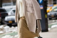 With white sweater, beige skirt and beige coat