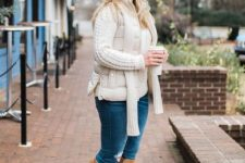 With white sweater, distressed jeans, scarf and beige suede high boots