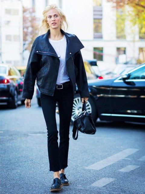 With white t-shirt, black leather jacket, black bag and flat shoes