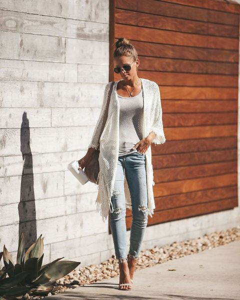 With white top, distressed jeans, beige bag and high heels