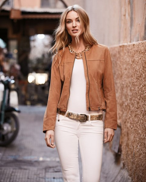 With white top, white pants, printed belt and golden necklace
