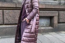 a beautiful berry-hued look with a purple sweater, pants, plum-colored sock booties and a purple puffer coat with a belt
