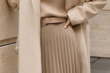 a beautiful look with a tan sweater, a matching pleated midi with a tan belt, a creamy coat is pure elegance