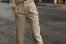 a beautiful neutral look with a cashmere turtleneck, pants, white shoes is pure elegance and chic