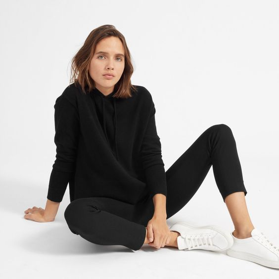 a black cashmere hoodie, black skinnies, white sneakers for a sporty and comfy everyday look