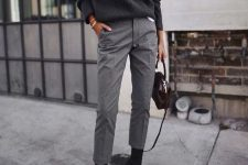 a black oversized turtleneck sweater, grey cropped pants, black sock boots and a small bag for winter