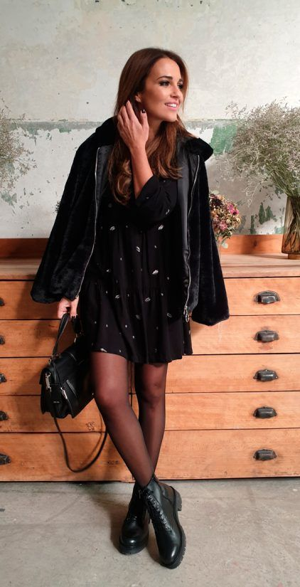 a black printed mini dress, black tights, combat boots, a shearling coat and a bag for a lovely girlish feel