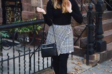 a black turtleneck, a grey tweed wrap mini skirt, black booties and stockings plus a black bag