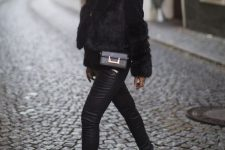 a bold and comfy winter look with a black faux fur jacket, leather leggings, white Chelsea boots, a black bag and a beanie