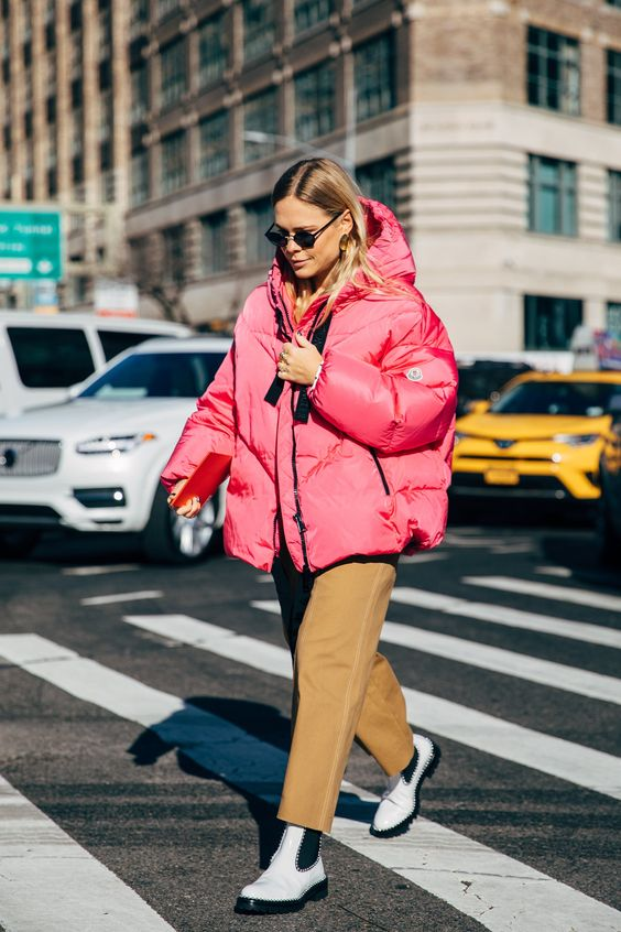 a bold casual look with a pink puff coat, tan pants, white Chelsea boots is all you need this winter