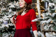 a bold outfit with a red long sleeve top, a burgundy A-line mini skirt and a red beret feels like 70s