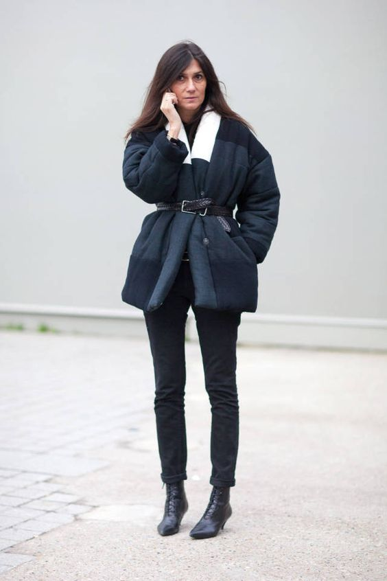 a casual winter look with black jeans, lace up booties, a black sweater and a plaid puffer coat with a leather belt