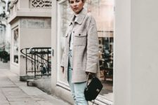 a casual winter outfit with light blue jeans, black Chelsea boots, a white turtleneck, a grey plaid coat and a black bag