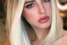 a chic long bob with ciy blonde balayage and straight hair with a volume is a beautiful idea