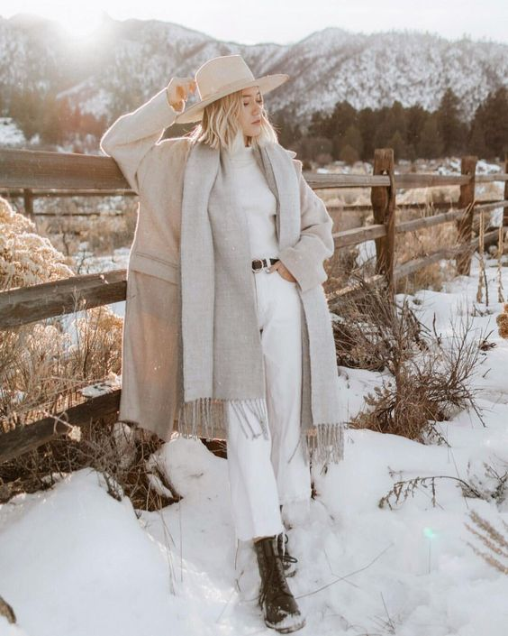 a classy winter look with white jeans, a white turtleneck, a grey scarf, a tan coat and a creamy hat plus black boots