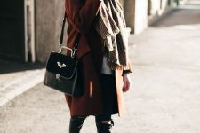 a cognac coat, a plaid neutral oversized scarf, white sneakers and a black bag for a chic look