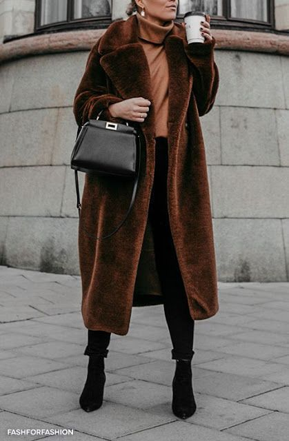 a comfortable look with a rust turtleneck, black skinnies, black booties, a brown faux fur coat and a black bag