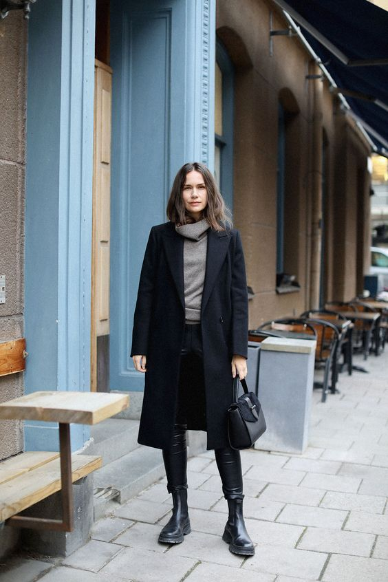 a comfortable winter look with a grey turtleneck, leather leggings, Chelsea boots, a black coat and a bag
