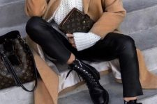 a comfy winter look with black leggings, boots, an oversized white turtleneck sweater, a camel coat and a brown bag