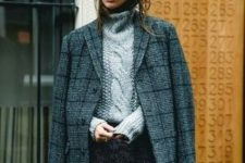 a cozy winter outfit with a grey braided sweater, a dark grey mini skirt, a grey plaid coat, tall black boots